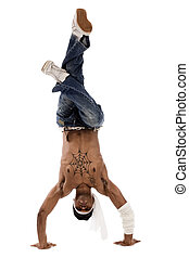 Hip hop dancer freezed his movements on isolated white...