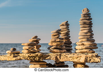Stones towers on coast - Balance a few stack of pebbles on...