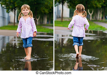 Girl to walk barefoot in a puddle splashing water in the...