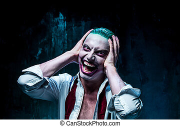 Bloody Halloween theme: crazy joker face - Bloody Halloween...