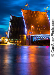 Swing bridge in St. Petersburg. - Swing bridge at night in...