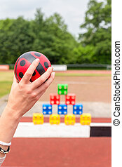 Arm with ball to throw off colored blocks - Girls arm with...