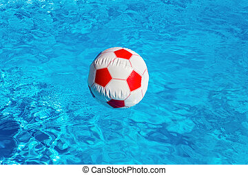 Beach ball floating  in blue swimming pool