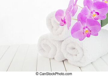 White bath towels and orchid flower - SPA concept: stack of...