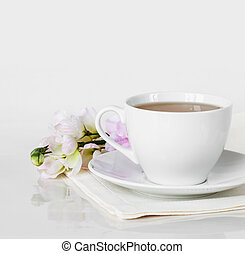 Cup of tea and flower - Hot tea in a white porcelain cup...
