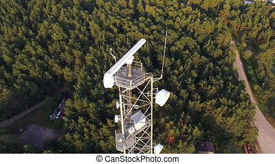 Telecommunications tower with radar system