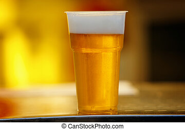 Plastic cup of beer, Disposable glass