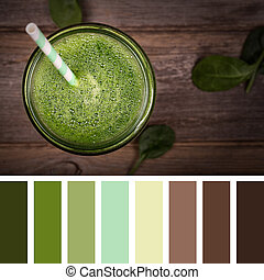 Green smoothie palette - Top view of a green smoothie on an...