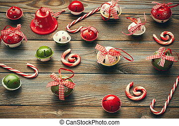 Christmas jingle bells decoration on wooden background