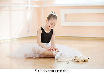 Ballerina changing dancing shoes - Young ballerina changing...