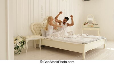 Couple Sitting bed dancing mix race man woman playing having...