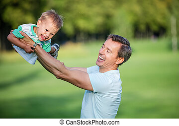 Father and toddler son having fun
