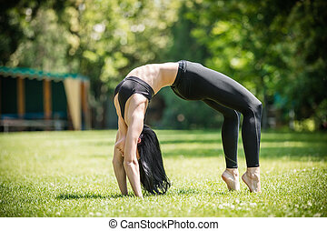 Woman performing bridge exercise - Young woman performing...