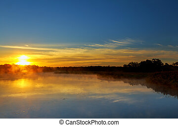 Sunrise over the lake with the reflection