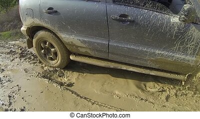 SUV. Forcing mud obstacles - SUV trying to pass a deep ditch...
