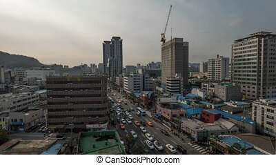 Timelapse of Seoul cityscape with car traffic on streets,...