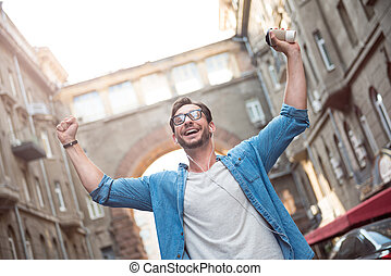 Happy man holding his hands up - Absolute happiness. Joyful...