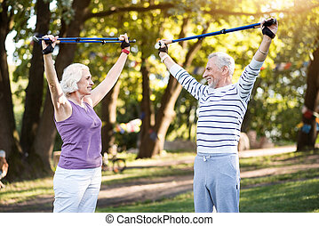 Good productive physical training of elderly couple in...