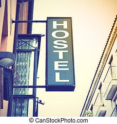 Signboard hostel. Retro style filtred image