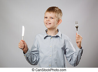Hungry child - Caucasian boy with fork and knife. Hungry...