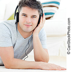 Portrait of a happy man with headphones looking at the camera