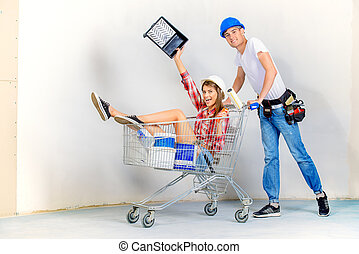house investment - Happy young couple went shopping for the...