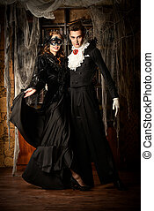evil and beauty - Gorgeous couple of vampires dressed in...