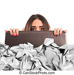 Submerged by the e-mail spam - Businesswoman hidden behind...