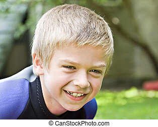 Eight year old boy smiling at the camera