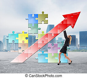 Build and sustain success - Businesswoman holding a puzzle...