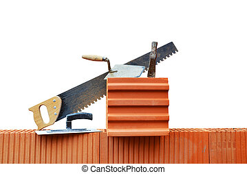 Masonry tools on a brick wall Bricklaying work