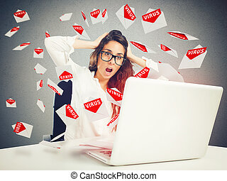 Despair and stress for spam e-mail - Desperate businesswoman...