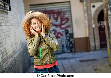 Young attractive black female in urban background - Portrait...