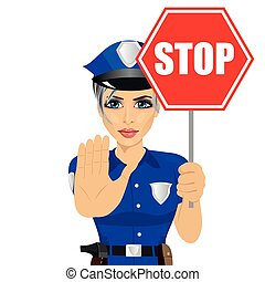 young policewoman holding stop sign and showing stop gesture...