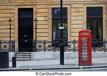 Red phone booths in central London. - Red phone booths on...