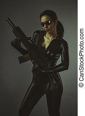 Machinegun, Brunette woman with enormous bulletproof vest...