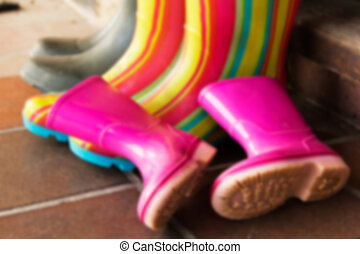 Colourful wellington boots left on a doorstep Out of focus -...