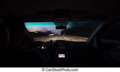 Timelapse of driving on night road - Timelapse shot of a man...