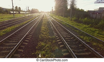 aerial view of railway tracks at sunset. The camera flies...