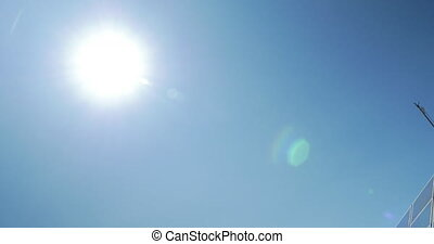 In blue sky seen bright sun, then seen solar panels - In...