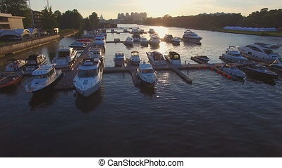 Aerial view of marina full yachts and boats at sunset -...