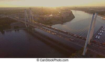 the cable-stayed bridge at sunset - Cable-Stayed Bridge in...