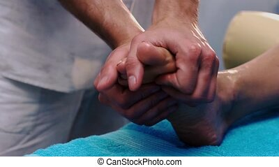 Male hands massaging patient's feet HD