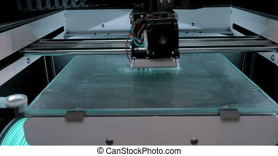 Timelapse of equipment printing 3D text - Timelapse shot of...