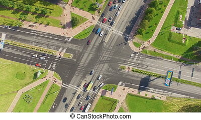 aerial view of crossroads. At the crossroads go cars and...