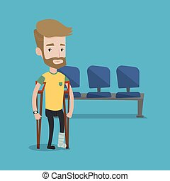 Man with broken leg and crutches - An injured hipster man...
