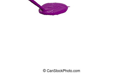 purple liquid flow falls on surface in slow motion. Colored paint