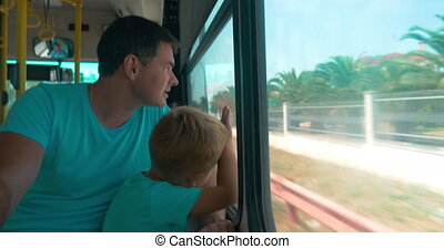 In city of Perea, Greece in bus are going father and son,...