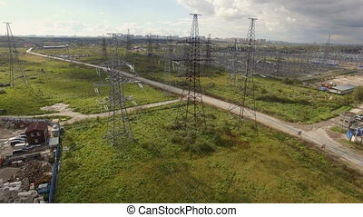 aerial view of high voltage pylons and power lines - aerial...