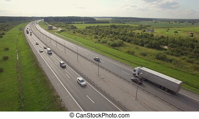 Aerial view of Highway. On the road going trucks and cars....